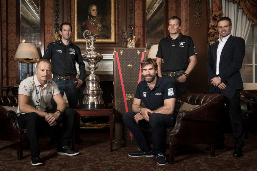 The Americas Cup 2017 - 2021 framework agreement press conference. Sir Ben Ainslie skipper of LandRover BAR, Franck Cammas skipper of Groupama Team France, Dean Barker skipper of SoftBank Team Japan, Iain Percy skipper of Artemis Racing and Jimmy Spithill skipper of Oracle Team USA. Shown here with the Americas Cup in London prior to the framework announcement.